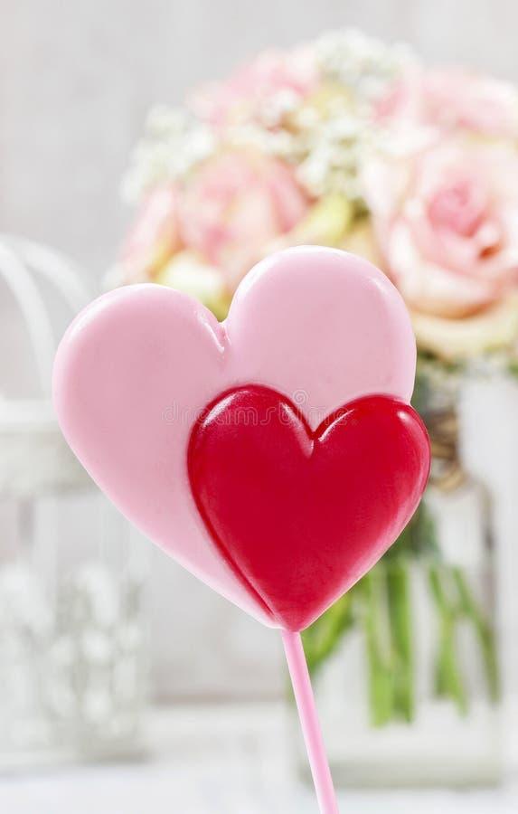 Lollipops in heart shape royalty free stock photography