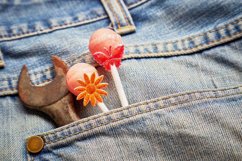 Lollipops in jeans pocket royalty free stock photos
