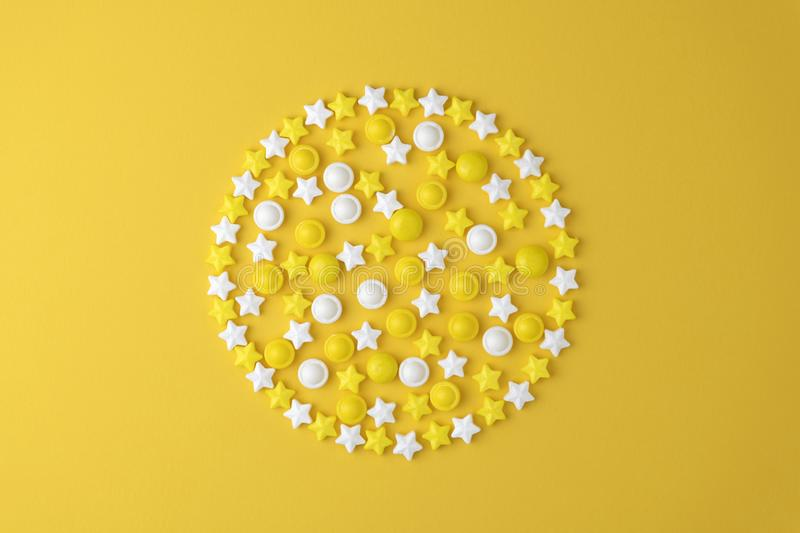 Lollipops sweets. Candy in shape circle, top view flat lay on yellow pastel background. Sweet sucker, lollipop, candy royalty free stock photos