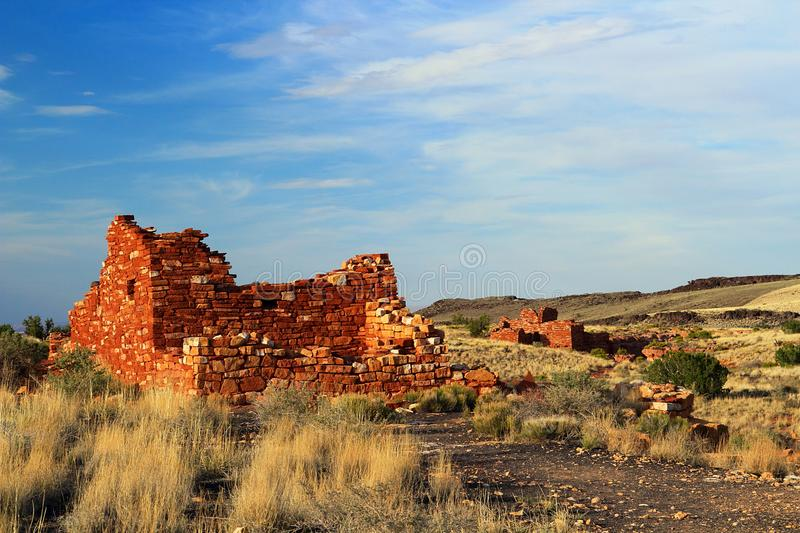 Box Canyon and Lomaki Pueblo Ruins in Evening Light, Wupatki National Monument, Arizona. Evening light is shining on the scattered pueblo ruins at the Box Canyon royalty free stock photo