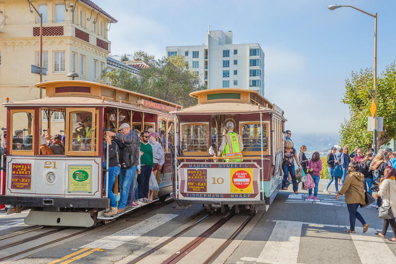 Lombard street stop. San Francisco, CA, United States - August 16, 2016: two Cable Car, Powell-Hyde lines meet. Crowds of tourists to the famous landmark of stock photos