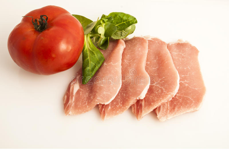 Lombo e tomate de carne de porco imagens de stock royalty free
