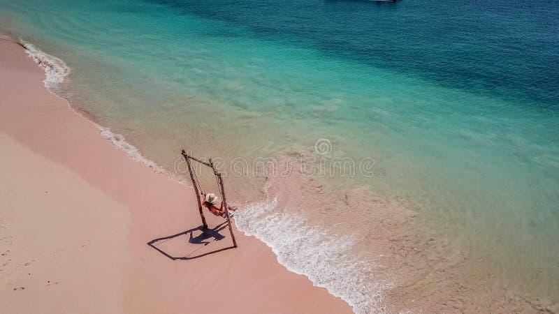 Lombok - girl on the swing stock photos