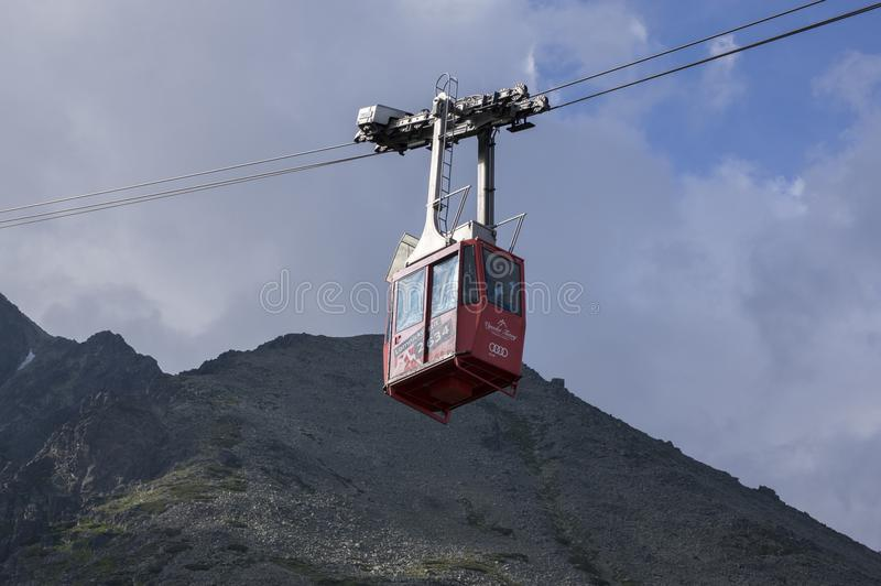 Lomnicky stit, High Tatra mountains / SLOVAKIA - July 6, 2017: Amazing aerial lift full of tourists from station Skalnate pleso to. Mount Lomnicky stit, red royalty free stock photos