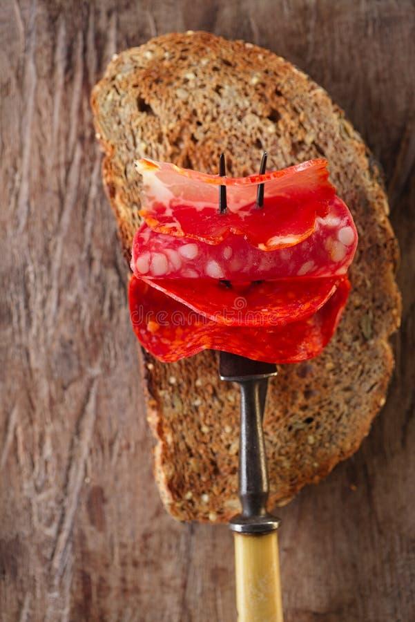 Lomo pork loin, chorizo pamplona, salchichon salame on meat for royalty free stock images