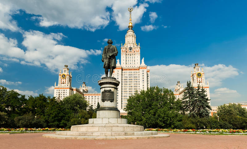 Lomonosov monument. And main building of Moscow state University royalty free stock photography