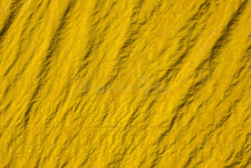 Lona amarrotada amarela velha com dobras e sombras Textura da superfície áspera ilustração do vetor