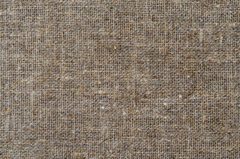 A lona de linho de creme de pano do fundo da textura foto de stock