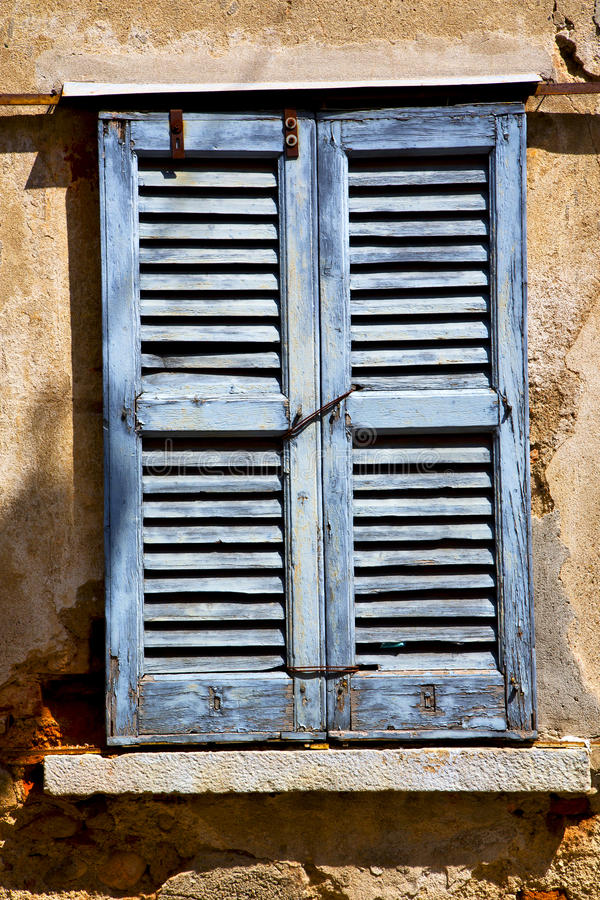 Lonate ceppino varese italy green wood venetian blind in the royalty free stock image