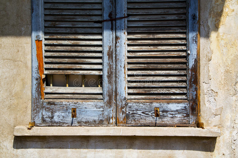 Lonate varese italy abstract window green wood venetian bl royalty free stock photography