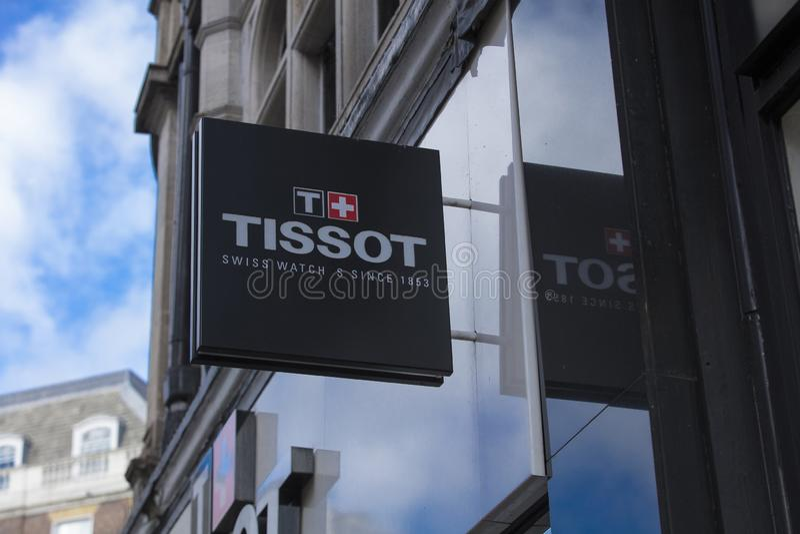 Londen, Groot Londen, het Verenigd Koninkrijk, 7 Februari 2018, a-teken en embleem voor Tissot stock foto's
