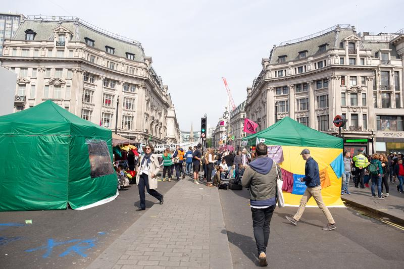 London - April 18 2019:- Protesters block the road in central London to protest the current environmental emergency. stock images