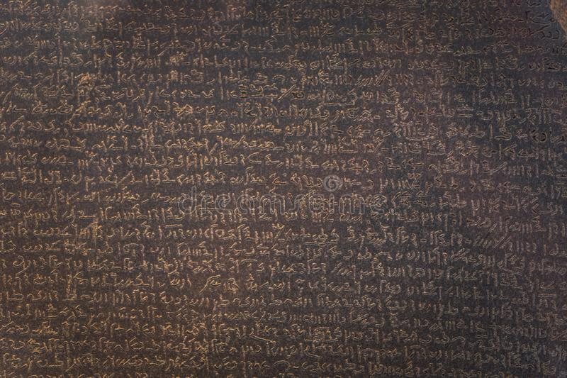 London - August 06, 2018: Details of the Rosetta Stone in the Brtitish Museum in London, England royalty free stock photos