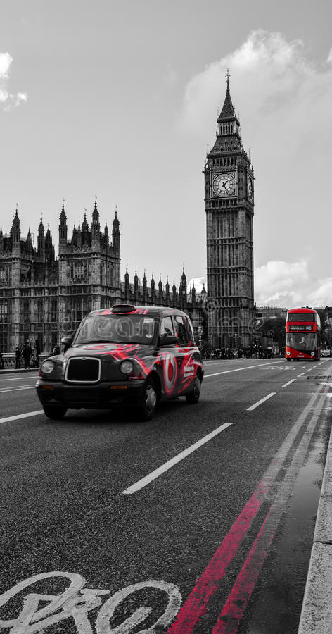 London Black taxi cab. A picture of a Red & Black Taxi Cab on Westminster Bridge in from of the iconic Big Ben (London royalty free stock image