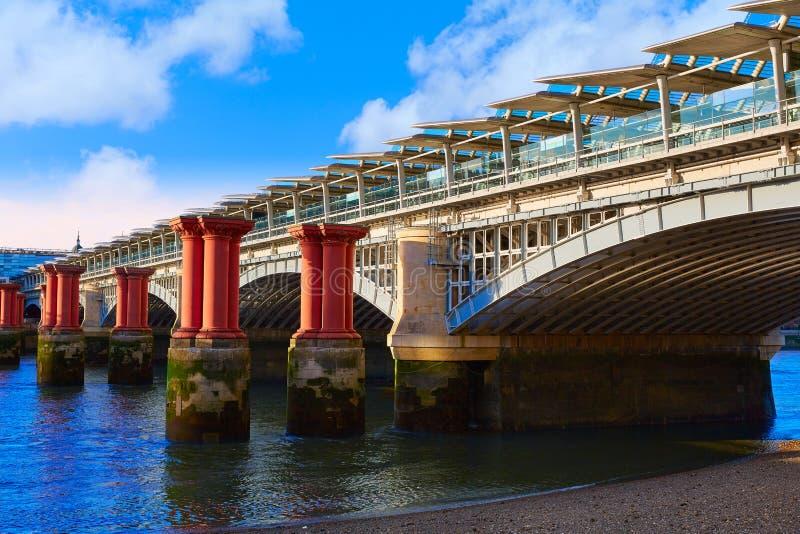 London Blackfriars Train bridge in Thames stock photography