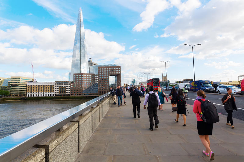 London Bridge with commuters in London, UK royalty free stock photography