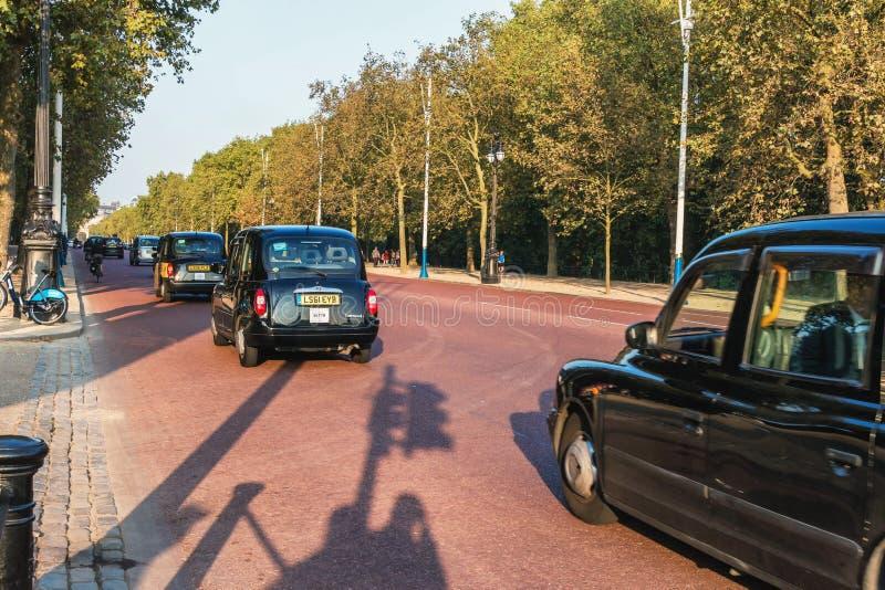 London, Britain - SEP 2014. Street views of london. Taxi ride down the street. Editorial. royalty free stock photos