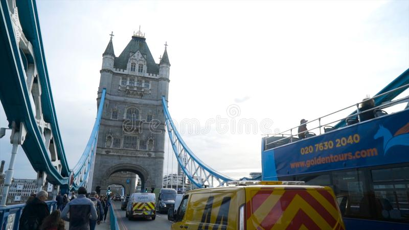 London, Britain-September, 2019: Ancient European bridge with architectural tower on sky background. Action. View from royalty free stock photo