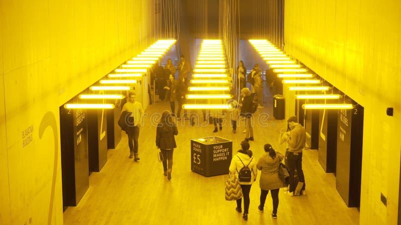 London, Britain-September, 2019: Public corridor in building with yellow light. Action. Underground city public transit stock photos