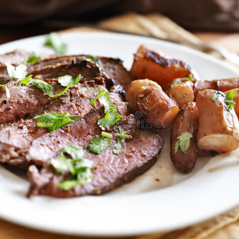 London broil beef roast. With french fingerling potatoes stock photography