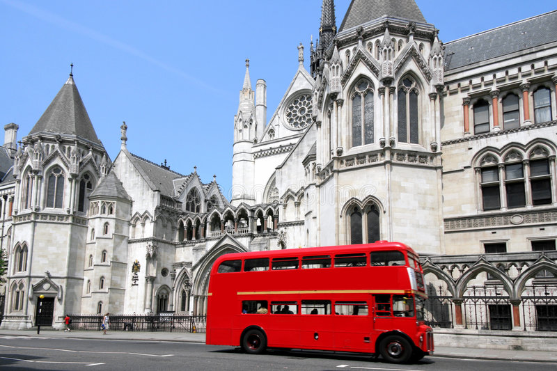 London bus and courthouse stock image