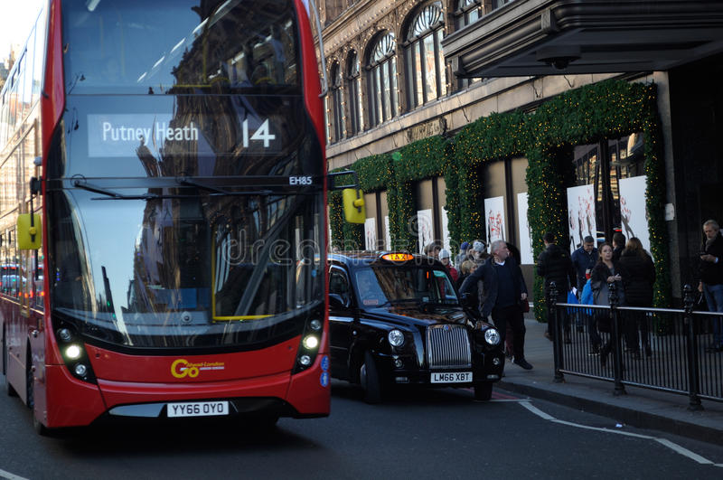 London, buses taxi and Harrods stock photos