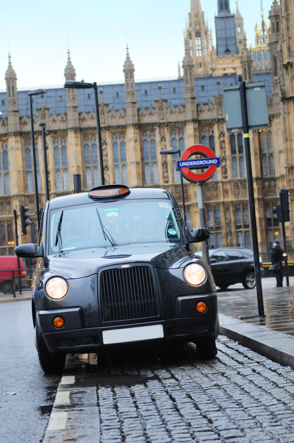 London cab. Black cab, landmark for London, waiting near Big Ben