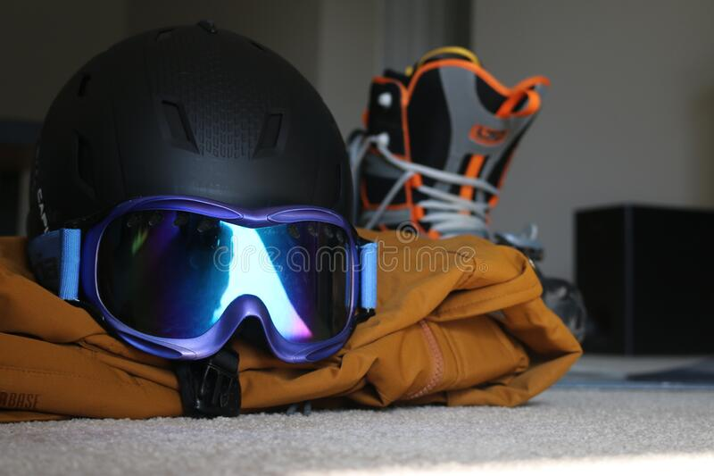 London Canada, February 14 2020: Editorial illustrative photo of snowboarding gear laying on ground. Theme of winter sport.  stock photography