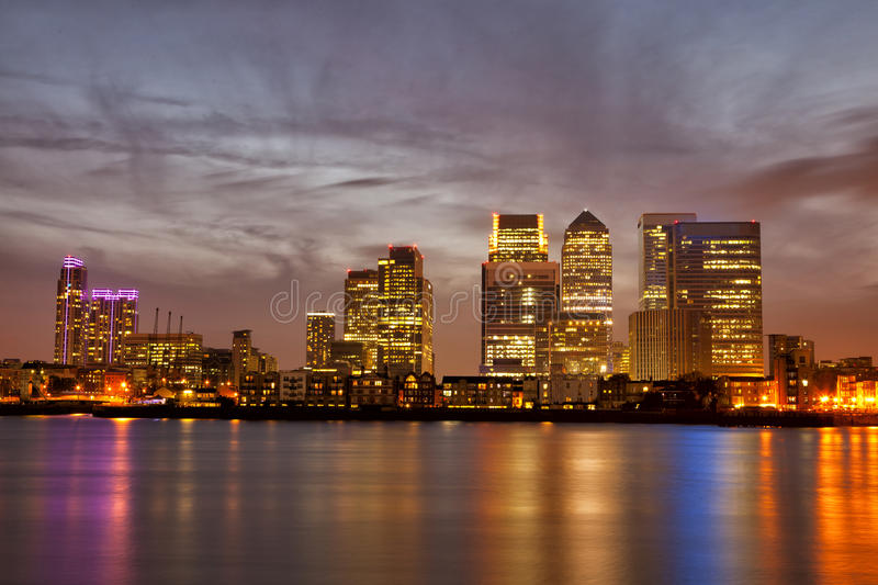 London Canary Wharf cityscape at night. Skyline of London Canary Wharf at sunset with colorful light reflections on Thames River royalty free stock photo
