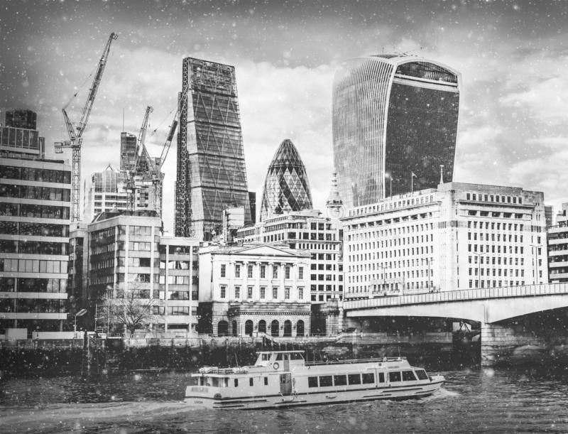 London City EC1 and Thames River view with snow falling in monochrome stock image