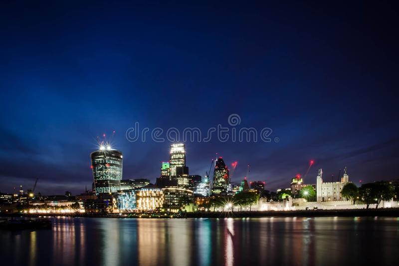 London city / England: City skyline in twilight near Tower Bridge stock photography