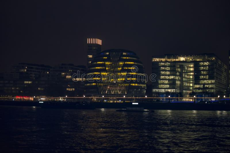 London city hall on the bank of river thames and its reflection. In water in night royalty free stock photos