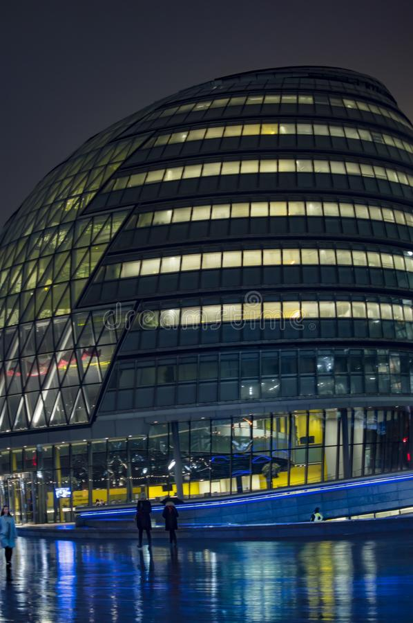 London city hall illuminated with lights. At night royalty free stock image