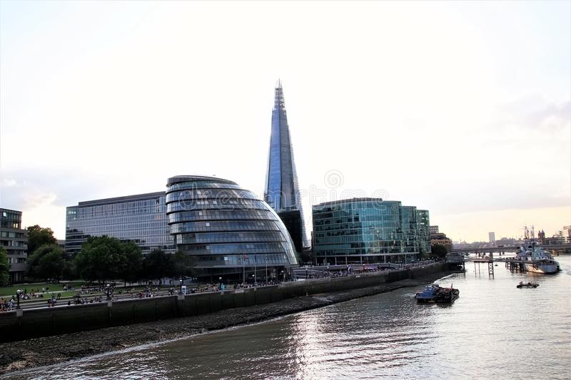 London City Hall, the Shard and River Thames. A landscape view of the River Thames with some of London`s modern architecture icons - London City Hall and The stock photos