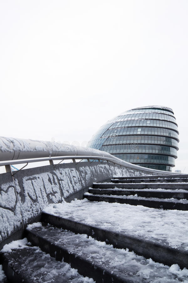 London city hall in snow. Stair and railing lead to london city hall that is covered by snow stock photo
