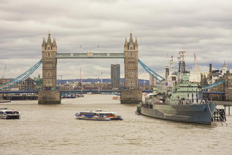 London city with Tower Bridge and HMS Belfast warship for tourists attraction royalty free stock photography