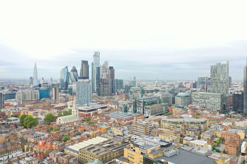 London Cityscape from the Air. Colorful drone shot looking south to the city of London, including landmarks like Gherkin, Shard, London Eye royalty free stock photography