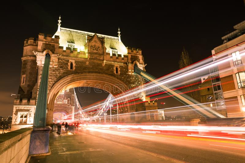 London Double Decker Bus Light Trails on Tower Bridge Road at Night stock photo