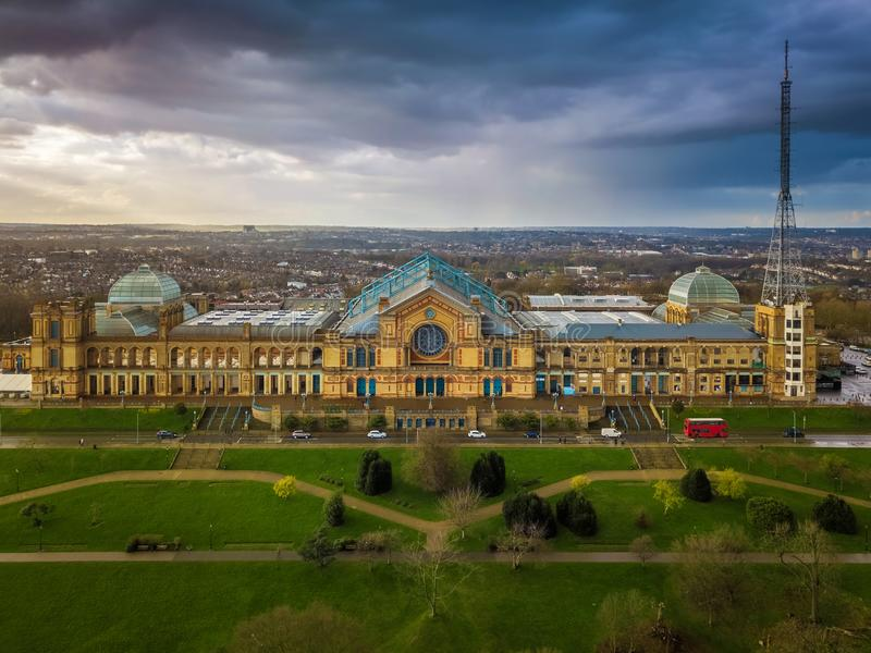 London, England - Aerial panromaic view of Alexandra Palace in Alexandra Park with iconic red double-decker bus stock image