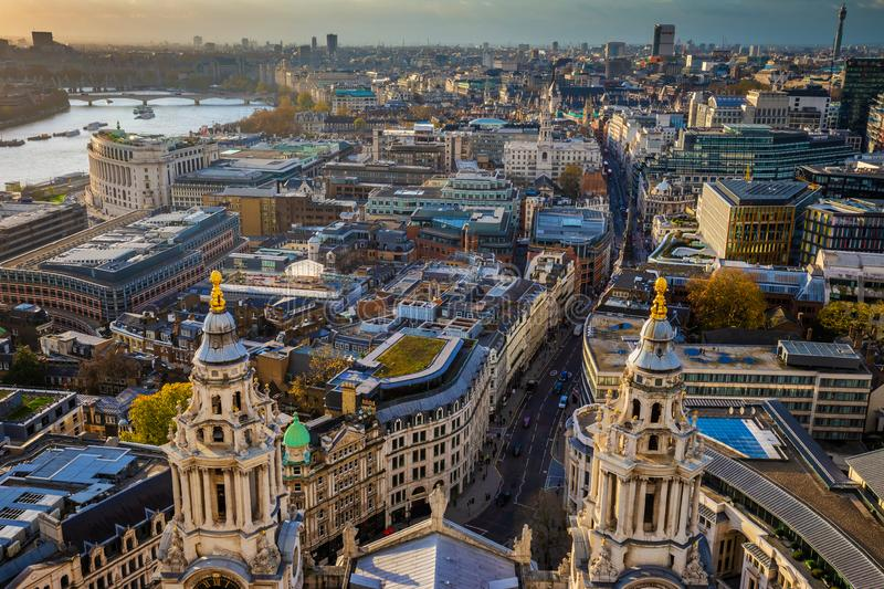 London, England - Aerial skyline view of London taken from top of St.Paul`s Cathedral. At sunset stock photography
