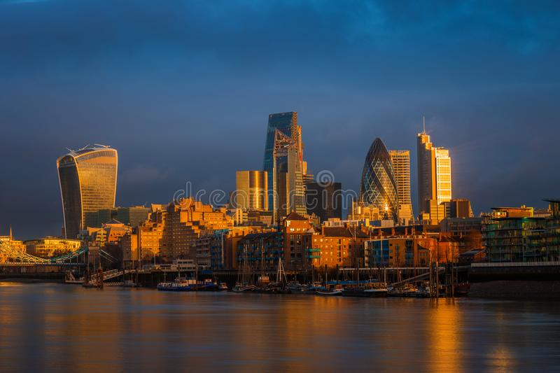 London, England - Amazing dramatic sky and golden hour sunlight at Bank District of London. With famous skyscrapers stock photography