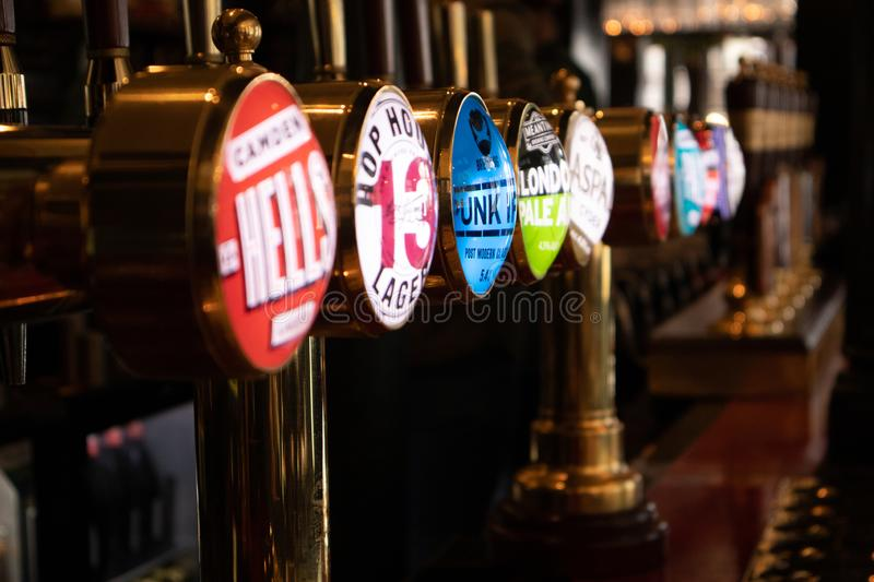 London, England - APRIL 1, 2019: Draught beer taps in a traditional pub in London stock photos