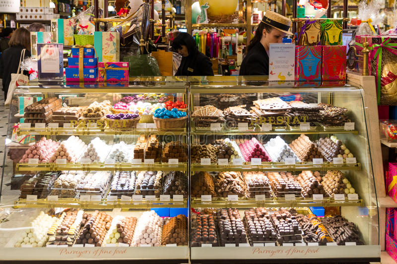 London, England - April 4, 2017: Harrods department store interior, candies and sweets area. Harrods is the biggest department st royalty free stock photography