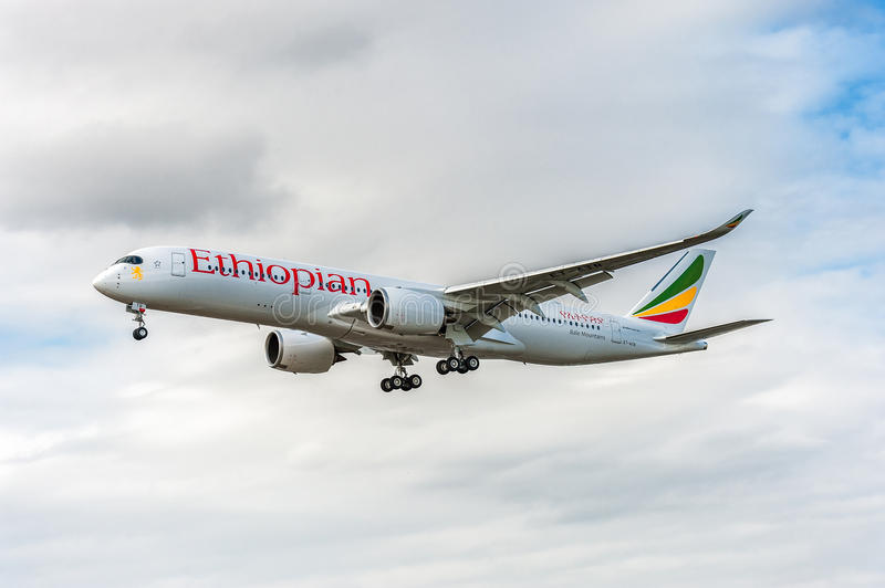 LONDON, ENGLAND - AUGUST 22, 2016: ET-ATR Ethiopian Airlines Airbus A350 Landing in Heathrow Airport, London. Airplane is landing in Heathrow Airport, London royalty free stock images