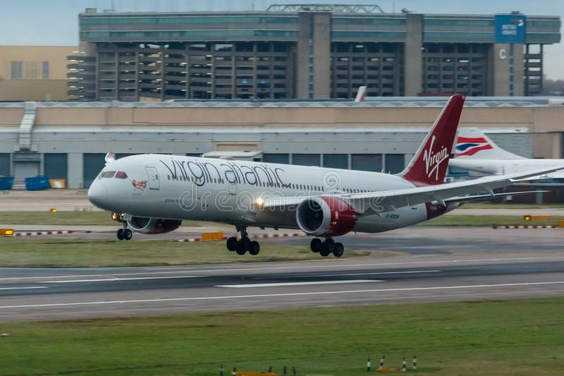 London, England - Circa 2019 : Virgin Atlantic Boeing 787 Dreamliner Aircraft G-VOOH Landing at London Heathrow Airport royalty free stock images