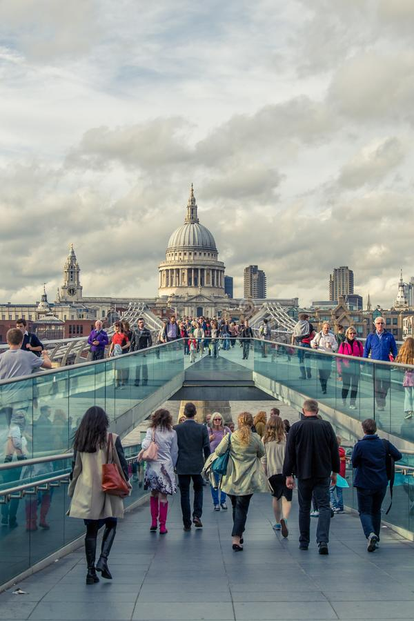City of London, Millennium bridge and St. Pauls cathedral in su royalty free stock photo