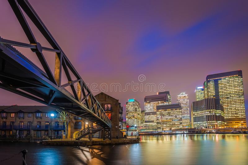 London, England - Colorful night sky at Canary Wharf financial district with skyscapers stock image