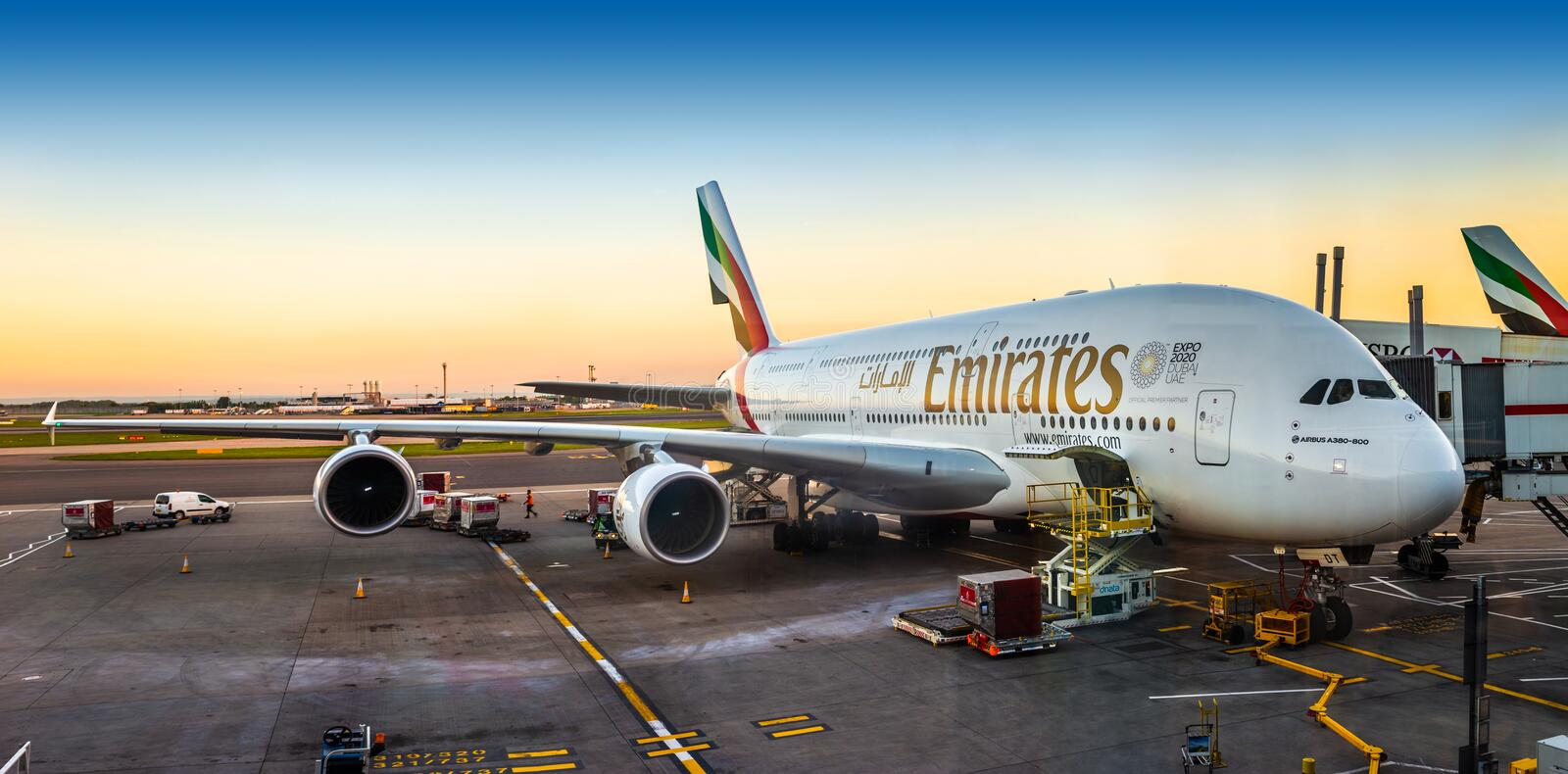 London, England - 05.05.2018: An Emirates Airbus A380-800 super. Jumbo aircraft waiting for passengers and loading at London Heathrow terminal 3 during sunset stock photos