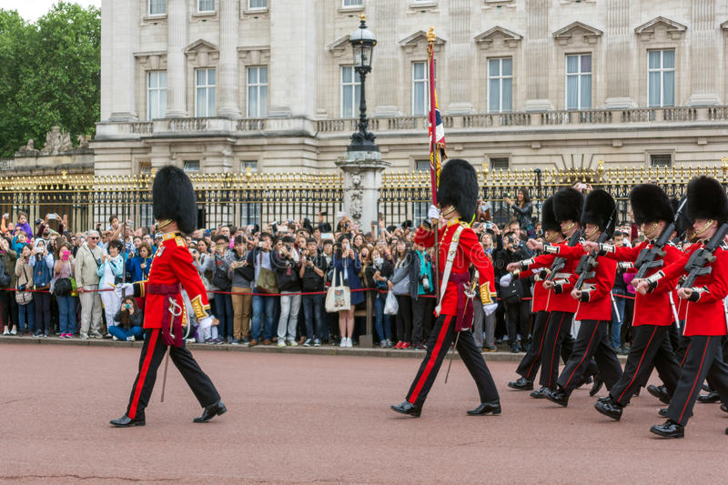 LONDON, ENGLAND - JUNE 17 2016: British Royal guards perform the Changing of the Guard in Buckingham Palace, London, Grea. LONDON, ENGLAND - JUNE 17 2016 royalty free stock image