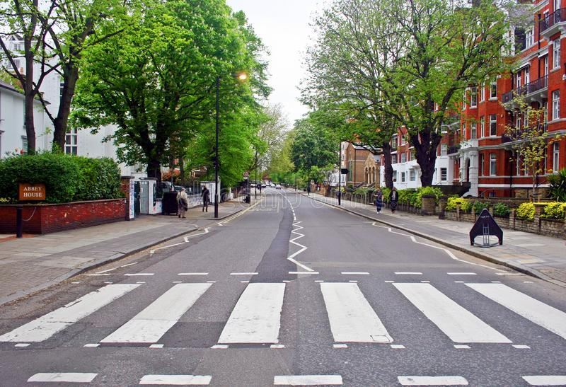 Abbey Road, London. LONDON, ENGLAND - MAY 10, 2012 : The famous scenery of zebra crossing at Abbey Road made famous by the 1969 Beatles album cover stock photography